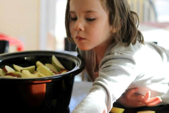 phoebe putting apples in pot