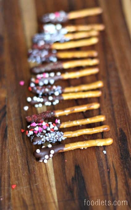chocolate-covered mini pretzel sticks with sprinkles