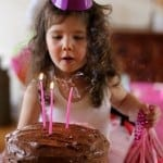 Estelle blowing out cake