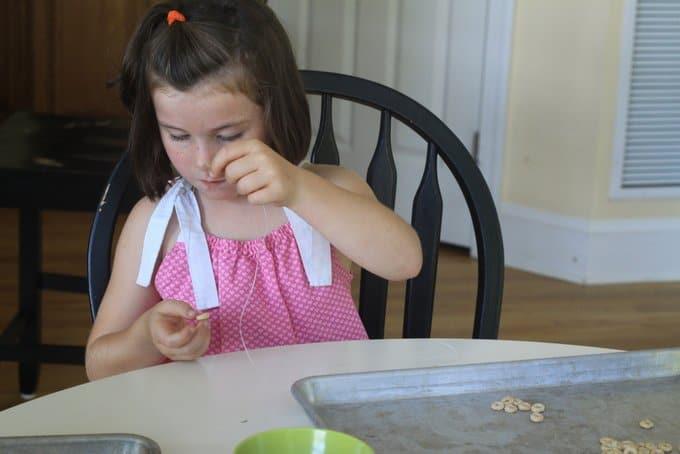 phoebe making necklace