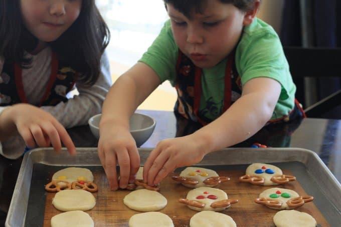 George and Estelle assembling reindeer sugar cookies