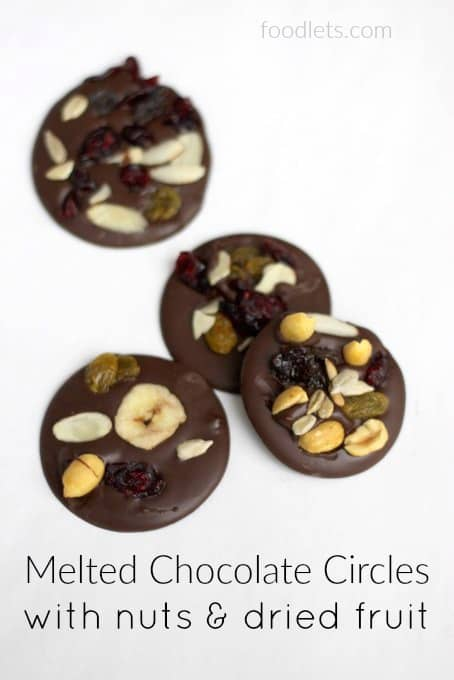 melted chocolate circles with nuts & dried fruit
