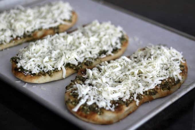 making pesto naan pizza